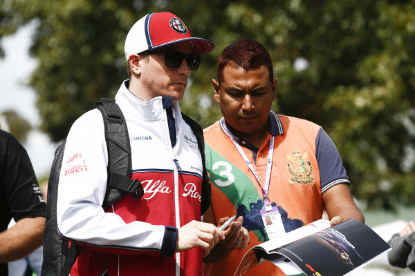 Kimi Raikkonen, Alfa Romeo Racing, signs an autograph for fans