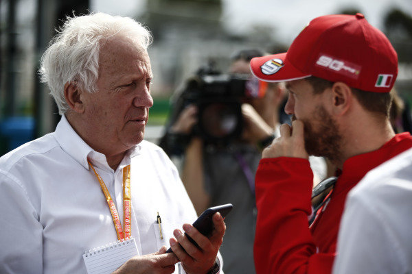 Charlie Whiting, Race Director, FIA, with Sebastian Vettel, Ferrari.