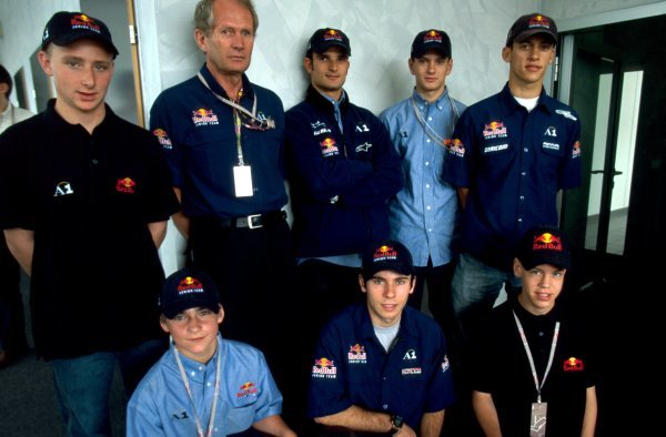 L-R: Reinhard Kofler (AUT), Martin Ragginger (AUT), Dr Helmut Marko (AUT), Ricardo Mauricio (BRA), Vitantonio Liuzzi (ITA) , Bernhard Auinger (AUT), Sebastian Vettel (GER), Patrick Friesacher (AUT), Red Bull Junior team at the Austrian Grand Prix. Austrian Grand Prix, A1-Ring, 10 May 2002. DIGITAL IMAGE