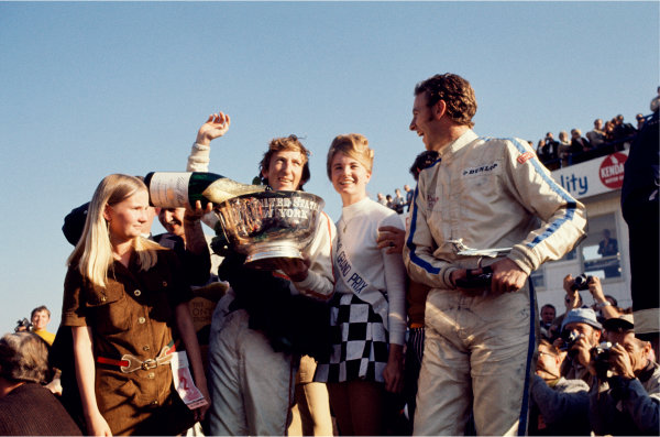 1969 United States Grand Prix, Watkins Glen. Jochen Rindt and Piers Courage on the podium World Copyright - LAT PhotographicExhibition ref: a100