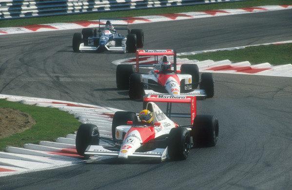1990 Italian Grand Prix.Monza, Italy.7-9 September 1990.Ayrton Senna leads Gerhard Berger (both McLaren MP4/5B Honda's) and Jean Alesi (Tyrrell 019 Ford) through the Rettifilo Chicane early on.Ref-90 ITA 16.World Copyright - LAT Photographic