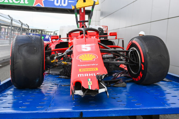 The damaged car of Sebastian Vettel, Ferrari SF1000, on a truck