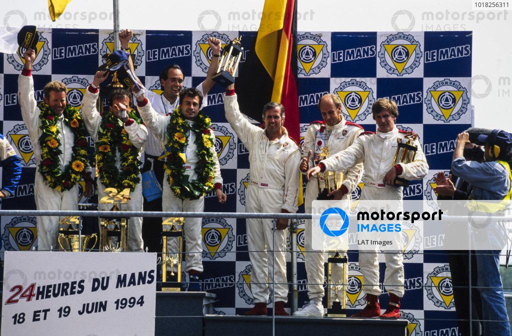 L to R: Hurley Haywood, Mauro Baldi, Yannick Dalmas, Max Welti, Danny Sullivan, Hans-Joachim Stuck Jr and Thierry Boutsen, celebrate on the podium.