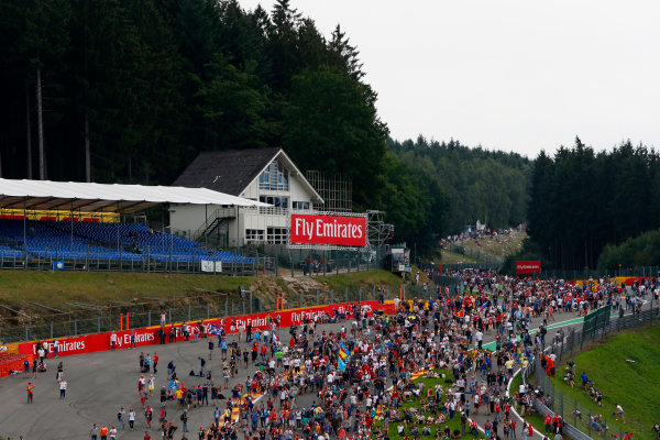 Spa-Francorchamps, Spa, Belgium. Sunday 23 August 2015. Fans invade the circuit after the race. World Copyright: Zak Mauger/LAT Photographic. ref: Digital Image _L0U5524