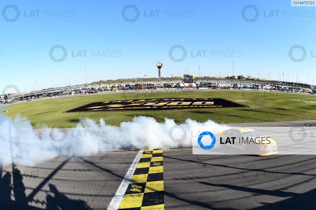 16-18 October, 2015, Kansas City, Kansas USA Joey Logano (22) does a burnout after winning. ©2015 John Harrelson / LAT Photo USA