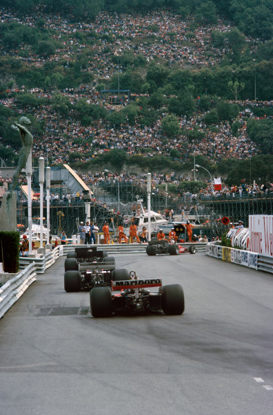 Monte Carlo, Monaco. 27th - 30th May 1976. The cars round the Swimming pool complex on lap 1, action.  World Copyright: LAT Photographic.  Ref: 76 MON 55.