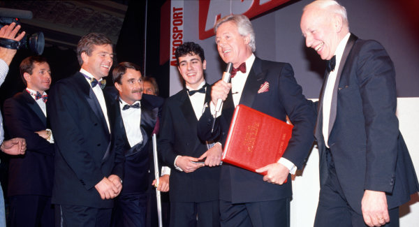 1992 Autosport Awards. Grosvenor House Hotel, Park Lane, London. 6th December 1992. Michael Aspel surprises John Surtees and presents him with the famous red book for This Is Your Life programme, portrait.  World Copyright: LAT Photographic. Ref:  Colour Transparency.