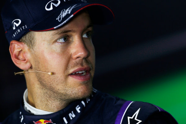 Marina Bay Circuit, Singapore. Saturday 21st September 2013.  Sebastian Vettel, Red Bull Racing, in the press conference after qualifying.  World Copyright: Charles Coates/LAT Photographic. ref: Digital Image _N7T5394