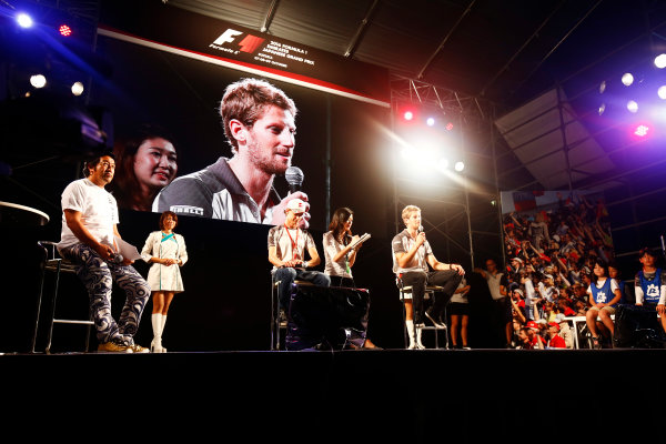 Suzuka Circuit, Japan. Saturday 08 October 2016. Esteban Gutierrez, Haas F1, and Romain Grosjean, Haas F1, at a fan event. World Copyright: Andy Hone/LAT Photographic ref: Digital Image _ONZ4789