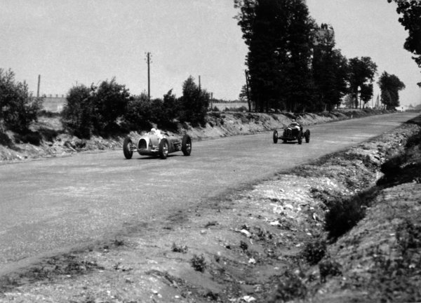 """1934 French Grand Prix Montlhery, France. 1 July 1934 August Momberger, Auto Union A, retired, leads Louis Chiron, Alfa Romeo Tipo-B """"P3"""", 1st position, action World Copyright: Robert Fellowes/LAT PhotographicRef: 34FRA06"""