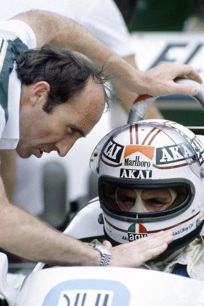 1981 Brazilian Grand Prix.Jacarepagua, Rio de Janeiro, Brazil. 27-29 March 1981.Alan Jones (Williams FW07C-Ford Cosworth), 2nd position, with Frank Williams. Portrait, helmet.World Copyright: LAT PhotographicRef: 35mm transparency 81BRA08