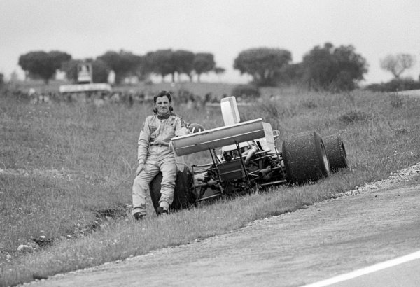 Graham Hill (GBR) Embassy Hill Lola T370, who retired from the race with a blown engine on lap 44, watches the race from the side of the track. Spanish Grand Prix, Rd 4, Jarama, Spain, 28 April 1974.
