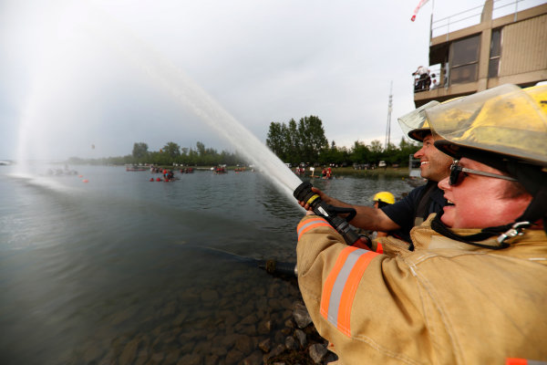 Circuit Gilles Villeneuve, Montreal, Canada. Saturday 10 June 2017. Firefighters aim their hoses at the participants in the raft race. World Copyright: Glenn Dunbar/LAT Images ref: Digital Image _X4I7239