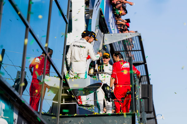 Albert Park, Melbourne, Australia. Sunday 26 March 2017. Sebastian Vettel, Ferrari, 1st Position, Lewis Hamilton, Mercedes AMG, 2nd Position, and Valtteri Bottas, Mercedes AMG, 3rd Position, celebrate on the podium. World Copyright: Zak Mauger/LAT Images ref: Digital Image _56I1990