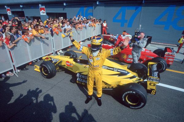 1999 Italian Grand Prix. Monza, Italy. 10-12 September 1999. Heinz-Harald Frentzen (Jordan Mugen Honda) celebrates his 1st position in parc ferme. Ref-99 ITA 02. World Copyright: Steven Tee/LAT Photographic Ref: 35mm Image 99 ITA 02