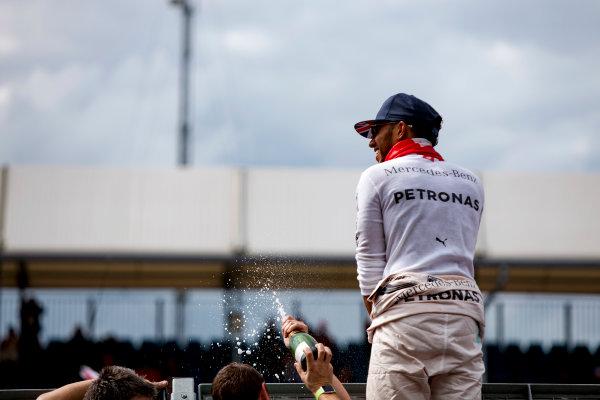 Silverstone, Northamptonshire, UK. Sunday 10 July 2016. Lewis Hamilton, Mercedes AMG, 1st Position, celebrates with the fans. World Copyright: Zak Mauger/LAT Photographic ref: Digital Image _79P8757