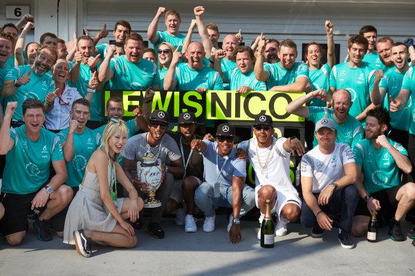 Hungaroring, Budapest, Hungary. Sunday 24 July 2016. Lewis Hamilton and Nico Rosberg celebrate with the Mercedes AMG team after the race. World Copyright: Steve Etherington/LAT Photographic ref: Digital Image SNE10782