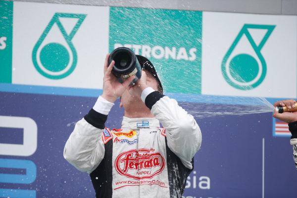 2013 GP2 Series. Round 1.  Sepang, Kuala Lumpur, Malaysia. 24th March 2013.  Sunday Race.  Stefano Coletti (MON, Rapax) celebrates his victory on the podium.  World Copyright: Alastair Staley/GP2 Series Media Service.  ref: _89P0651