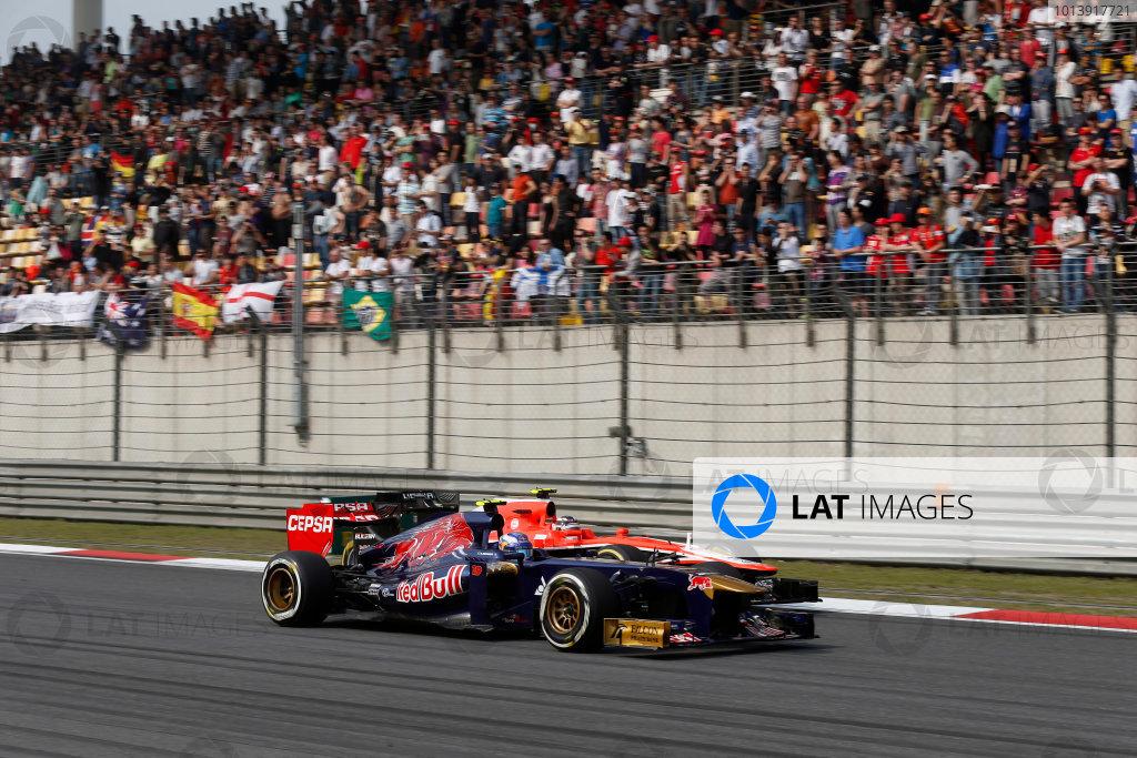 Shanghai International Circuit, Shanghai, China Sunday 14th April 2013 Daniel Ricciardo, Toro Rosso STR8 Ferrari, passes Max Chilton, Marussia MR02 Cosworth.  World Copyright: Charles Coates/LAT Photographic ref: Digital Image _N7T6470