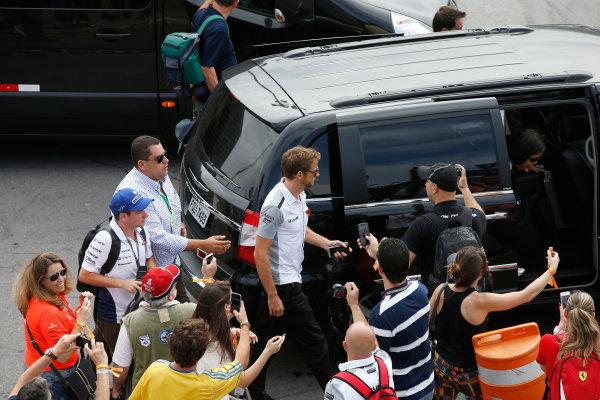 Interlagos, Sao Paulo, Brazil. Sunday 9 November 2014. Jenson Button, McLaren, poses for photos with fans. World Copyright: Charles Coates/LAT Photographic. ref: Digital Image _J5R5487