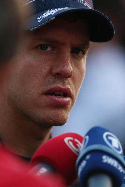 Marina Bay Circuit, Singapore.20th September 2012.Sebastian Vettel, Red Bull Racing, is interviewed.World Copyright: Andy Hone/LAT Photographicref: Digital Image HONZ1091
