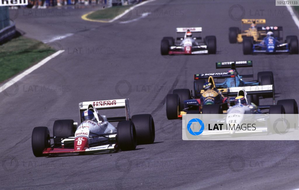 1989 Portuguese Grand Prix.Estoril, Portugal.22-24 September 1989.Derek Warwick (Arrows A11 Ford) leads Roberto Moreno (Coloni C3 Ford).World Copyright - LAT Photographic