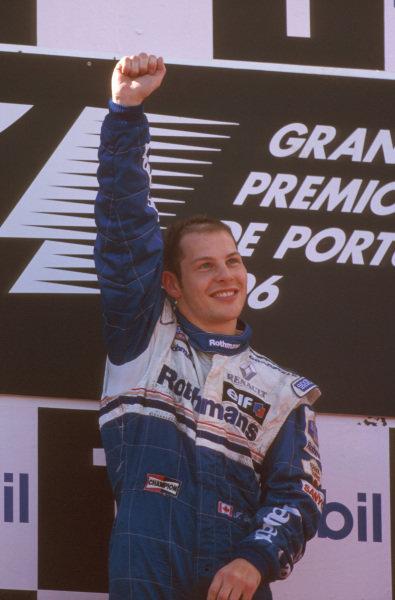 Estoril, Portugal.20-22 September 1996.Jacques Villeneuve (Williams Renault) 1st position celebrates on the podium.Ref-96 POR 02.World Copyright - LAT Photographic