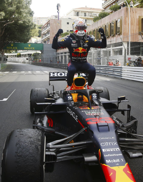 Max Verstappen sits on the airbox of his  Red Bull RB16 Honda in Parc Ferme as he celebrates winning the race.