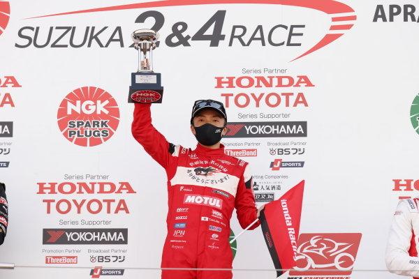 Winner Tomoki Nojiri, Team Mugen, Dallara SF19 Honda, raises his trophy on the podium