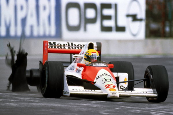 Ayrton Senna (BRA) McLaren MP4/5B limps back to the pits having lost the lead of the race with a puncture. He was classified in twentieth and last position. Formula One World Championhip, Rd6, Mexican Grand Prix, Mexico City, Mexico, 24 June 1990.