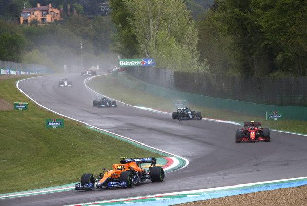 Lando Norris, McLaren MCL35M, leads Carlos Sainz, Ferrari SF21, Lance Stroll, Aston Martin AMR21, and Valtteri Bottas, Mercedes W12