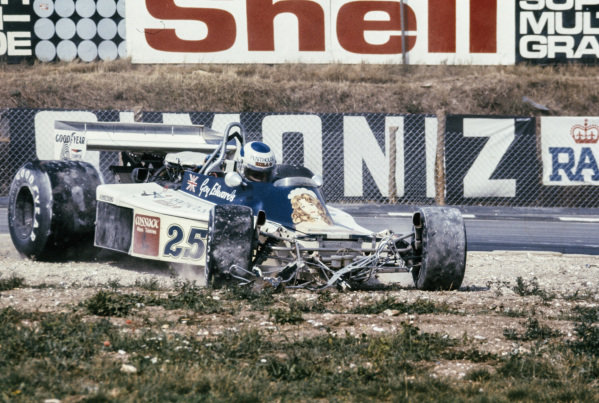 Guy Edwards destroys the front end of his Hesketh 308D Ford in a first lap accident.