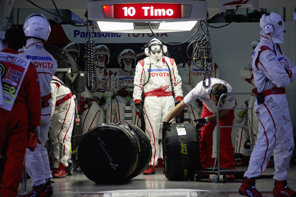 Mechanics prepare the tyres for Timo Glock's pit stop.