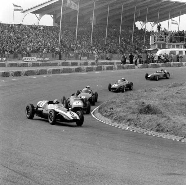 1959 Dutch Grand Prix.Zandvoort, Holland.29-31 May 1959.Jack Brabham (Cooper T51-Climax) leads Tony Brooks (Ferrari Dino 246) and Harry Schell (BRM P25). Brabham finished in 2nd position.Ref-4107.World Copyright - LAT Photographic