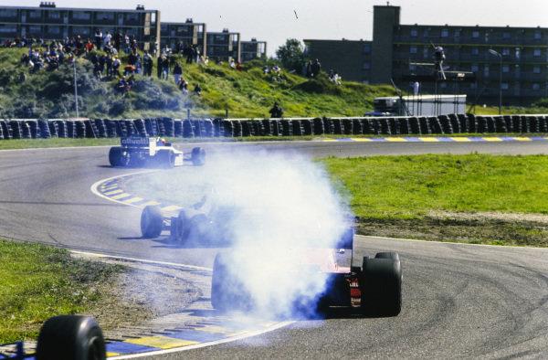 Marc Surer, Brabham BT54 BMW, leads Stefan Bellof, Tyrrell 014 Renault, and a smoking Ferrari 156/85.