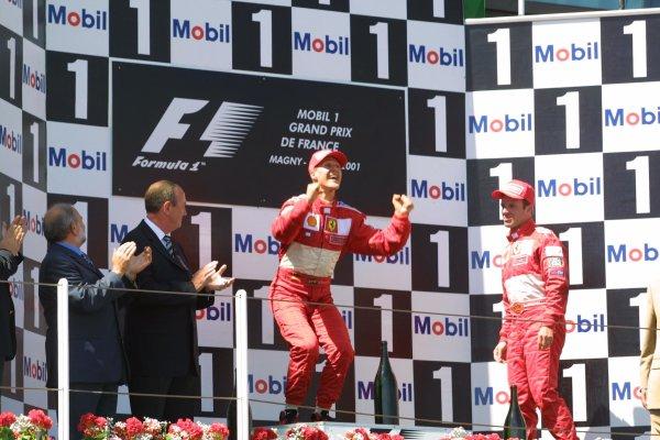2001 French Grand Prix - RaceMagny-Cours, France. 1st July 2001Michael Schumacher, Ferrari F2001, celebrates his 50 GP win, alongside Rubens Barrichello, Ferrari F2001 (3rd) - podium.World Copyright - LAT Photographicref: 8 9 MB Digital File only
