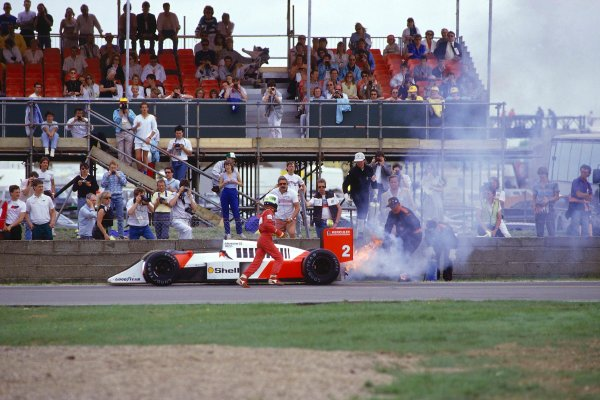 1987 British Grand Prix.Silverstone, England.10-12 July 1987.Stefan Johansson (McLaren MP4/3 TAG Porsche) retires from the race after an engine failure caused his car to catch fire.Ref-87 GB 41.World Copyright - LAT Photographic