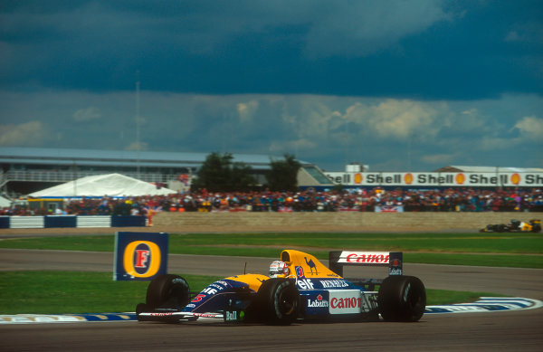 1992 British Grand Prix.Silverstone, England.10-12 July 1992.Nigel Mansell (Williams FW14B Renault) 1st position at Luffield.Ref-92 GB 05.World Copyright - LAT Photographic