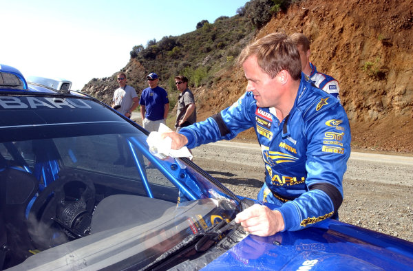 World Rally Championship, Cyprus Rally, April 18-21, 2002.Tommi Makinen cleans the windscreen on his Subaru Impreza WRC 2002 before the first of the final day's stages.Photo: Ralph Hardwick/LAT