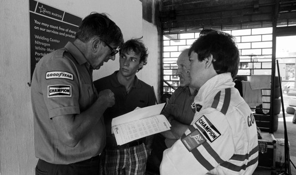 (L to R): Ken Tyrrell (GBR) Team Owner chats to Stefan Bellof (GER) and Martin Brundle (GBR) Tyrrell.