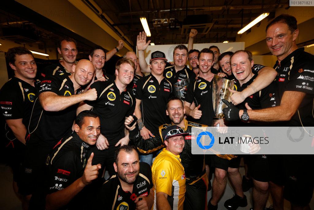 Yas Marina Circuit, Abu Dhabi, United Arab Emirates Sunday 4th November 2012. Kimi Raikkonen, Lotus GP, 1st position, celebrates victory with his team. World Copyright:Andrew Ferraro/  ref: Digital Image _79P4146