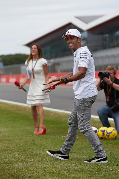 Silverstone, Northamptonshire, England. Thursday 3 July 2014. Lewis Hamilton, Mercedes AMG. World Copyright: Steve Etherington/LAT Photographic. ref: Digital Image SNE20064