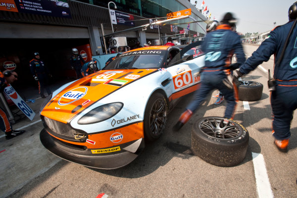 6 Hours of Zhuhai.Zhuhai, China. 11th - 13th November 2011. Fabien Giroix / Roald Goethe / Michael Wainwright, Gulf AMR Middle East, Aston Martin Vantage in the pits. Action. Drew Gibson/LAT Photographic. ref: Digital Image _Y8P0347