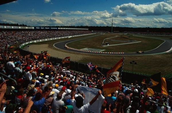 The large crowd in the Hockenheim stadium cheer on the drivers.
