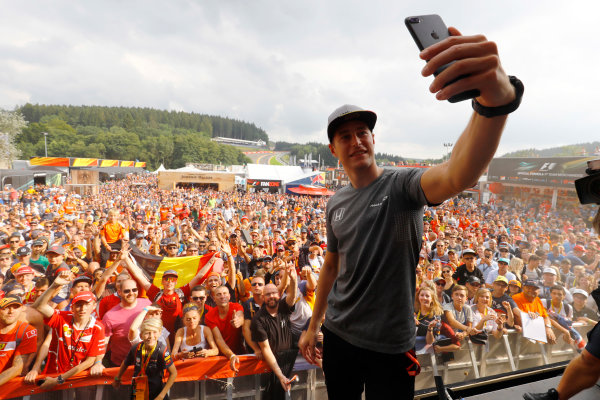 Spa Francorchamps, Belgium.  Saturday 26 August 2017. Stoffel Vandoorne, McLaren, takes a photo of himself with the crowd behind him, from the F1 Fanzone stage. World Copyright: Steven Tee/LAT Images  ref: Digital Image _R3I0491