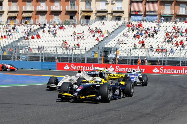 Valencia Spain. 27th June. Sunday Race. Marcus Ericsson (SWE, Super Nova Racing) leads Giedo Van der Garde (NED, Barwa Addax Team) and Michael Herck (ROU, DPR). Action. Portrait. Photo: Andrew Ferraro/GP2 Media Service. Ref: _O9T4576 jpg