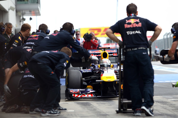 Nurburgring, Germany.22nd July 2011Sebastian Vettel, Red Bull Racing RB7 Renault, comes in for a stop. Action. Pit Stops. World Copyright: Andy Hone/LAT Photographicref: Digital Image CSP11001