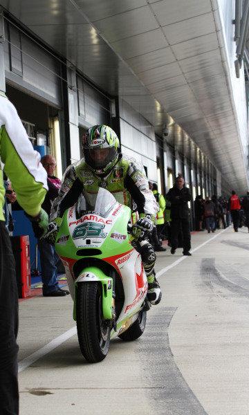 British Grand Prix. Silverstone, England. 10th-12th June 2011. Loris Capirossi, Ducati, returns to his pit. World Copyright: Kevin Wood/LAT Photographic. ref: Digital Image