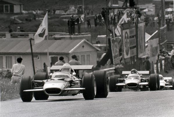 1969 Dutch Grand Prix.Zandvoort, Holland. 21 June 1969.Jochen Rindt, Lotus 49B-Ford, retired, leads Graham Hill, Lotus 49B-Ford, 7th position, and Jackie Stewart, Matra MS80-Ford, 1st position, action.World Copyright: LAT PhotographicRef: Autocar b&w print