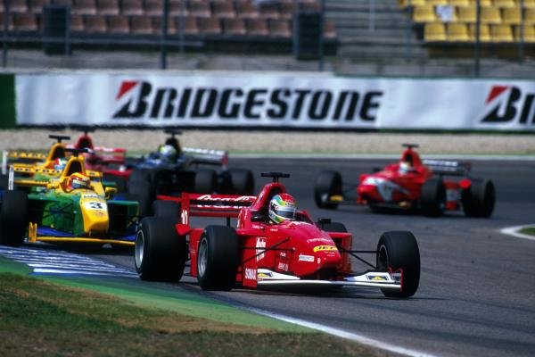 Justin Wilson (GBR) Nordic Racing leads the first time race winner  Antonio Pizzonia (BRA) Petrobras Junior Team through the Stadium Section.